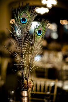 bronze and peacock feathers  http://www.stylemepretty.com/gallery/search/picture/31259?s=peacock=13