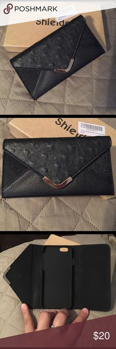 iPhone 6 wallet case. Brand new!! NWOT. Bought but decided to get another one. Has two card slots & a larger slot to put some cash. Price is firm! Accessories Phone Cases