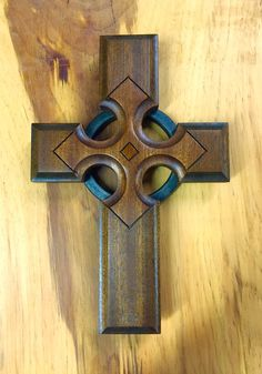 The star on this cross represents the light of Christ reaching the four corners of the world. Made from one solid piece of Mahogany. Each star is engraved by hand. The star itself has a gloss laquer applied to give it a higher sheen.