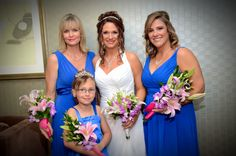 """My beautiful bridesmaids in """"Horizon"""" blue from David's Bridal, or cobalt blue.  They had tropical bouquets in pink and fuchsia."""