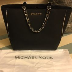 Michael Kors handbag So chic and in great condition! Selling incase someone is interested to match it up with the Limited Edition wallet I have posted. It has a double strap to be used as a handbag or as a shoulder bag. Has a middle compartment to hide belongings. Comes with dust bag. Sale price is firm. Michael Kors Bags Shoulder Bags