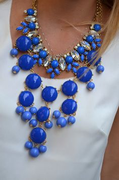statement necklace (love the blue with the white shirt)
