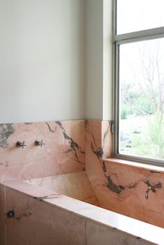 pink marble bath With so many variations on a theme, it's not difficult to see how marble patterns continuously evolve. But, seriously – who would have thought I'd love actual pink marble (in a bath no less) so much
