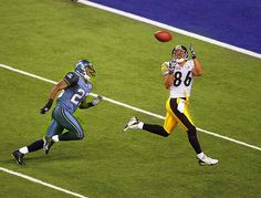 Steelers WR Hines Ward seals the deal (and MVP honors) with this perfect catch for a TD in the fourth quarter to give Pittsburgh a 21-10 win over the Seahawks in Super Bowl XL. (2006)