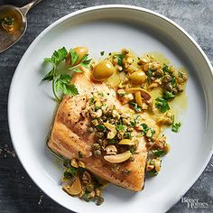Arctic Char with Green Olive and Lemon Dressing: Didn't have char, so I substituted salmon and it came out great.  Even my 10-year-old son loved it.  I could see multiplying this recipe for a dinner party and serving with wild rice pilaf or orzo, then green beans with bacon or spinach salad, and a pomegranate studded panna cotta desert.  Yum!