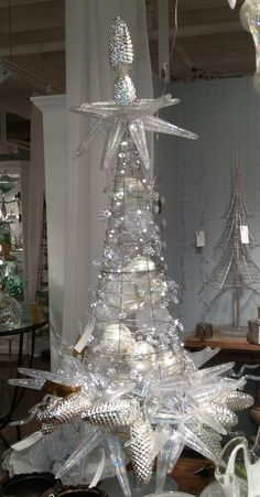Glass ornament Christmas tree......this looks like one of those tomato cages. Add more wire, lights and whatever ornaments fit your color scheme.: