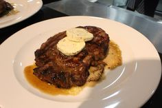 Grilled Black Angus Rib-eye Steak with Wild Mushrooms Ragout and Truffle Butter
