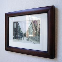 This is an old picture of the street where I live (taken in 1930?). It's hanging on the wall in my living room. When you look closely at the reflection you can see the same street as it is today.     . This is too much,great! You can see some great frames here: