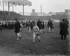 1917 World Series, Polo Grounds NY. Note dark hats for road uniform and unique sweaters. Manager Rowland's son in front, Byrd Lynn with oversized catcher's glove visible. Locker rooms in NY Polo Grounds were in Center Field, thus players walked length of field to get to dugout.