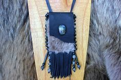 "Small Medicine Bag made from Black Goatskin Leather and Soft Beige Sheep Fur Gemstones on this bag include: Labradorite Cabochon and Stone Beads Dark Green Kambaba Jasper Bag Dimensions 2"" x 3"" with T"
