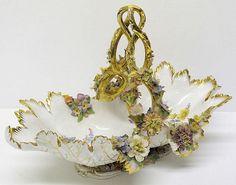 A late Meissen style flower encrusted basket.