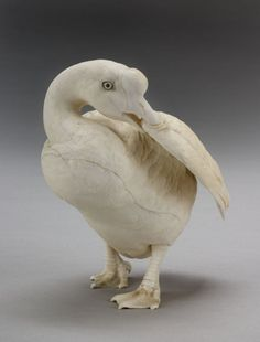 Okimono Goose, Signed Mitsumasa  Japan  Circa 1900  Standing with neck turned preening its right wing, with inset mother of pearl eyes.