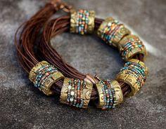 Clay bead with seed beads. Beautiful!