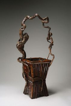 Flower arranging basket made in Japan in the 20th century (source).