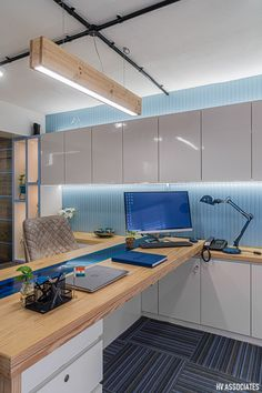 The blue office interior is lightened up with some plantation and a wooden staircase. U Shaped Office Desk, Office Office, Office Plan, Office Workspace, Office Furniture Design, Workspace Design, Office Interior Design, Office Interiors, Contemporary Office
