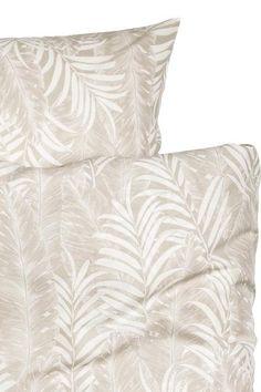 Parure de couette lit double en fil de coton fin à motif imprimé de feuilles de palmier. Housse fermée par boutons-pression métalliques dissimulés à la base