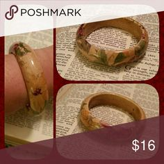 Vintage porcelain floral bangle bracelet This bangle bracelet has a beautiful floral design on it. The background color is tan and the flowers are burgundy, yellow, and green. No chips, in perfect excellent used condition. Jewelry Bracelets