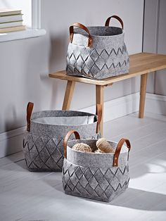 Store everything from books and magazines to toys and teddies in our set of three handy baskets. Made from grey felt, each has an attractive chevron pattern and two polyurethane leather handles for easy carrying.