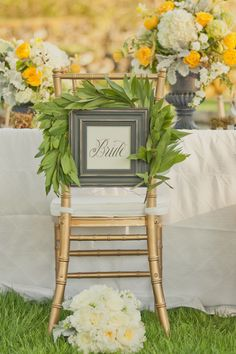 love these plae names attached to the back of the chairs. you could thift frames for all guests and write their names in each and that in turn is their favour