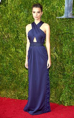 In the navy! Model-turned-actress Emily Ratajkowski stepped out in an embellished blue dress with a crisscrossed bodice, cinched at the waist with a wide belt.
