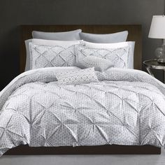 The Echo Design Dot Kat bedding collection creates a casual modern aesthetic and features an all over dot pattern in a soft shade of grey. The pintucks on the duvet cover create texture and add dimens