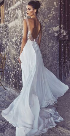 Stunning sheer scoop back wedding dress with gorgeous full skirt; Featured Dress: Elbeth Gillis