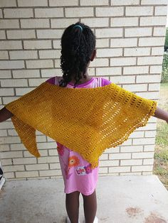 Sarah's Grove is a wrap or kerchief roughly scalene in shape. It begins with a tiny number of stitches at one side and gradually increases in length and width. It is finished with a lacy border along one edge.