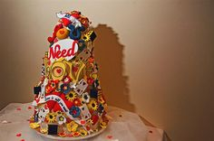 all you need is love wedding cake, image by Chris Barber Photography