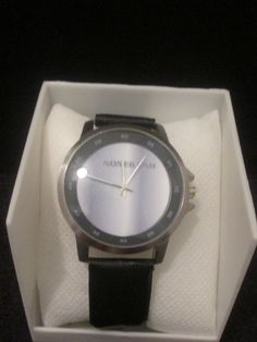 Noneillah's big face black leather band with bluish grey design watch $40.