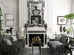 """Living room in the New York town house of Laura & Harry Slatkin.  Porphere and Thassos marble mantle was designed for the room by Howard Slatkin, as was the """"Liliane"""" hand-embroidered carpet from the Howard Slatkin Collection at Stark Carpet. Interior design by Howard Slatkin Photograph by Douglas Friedman"""