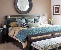 A Peaceful Place ~ If you?re looking to do blue in your bedroom but want a little variety, try teal. The rich tone has a twinge a green, giving basic blue an eye-catching variation. In this bedroom, a soothing palette of soft teals, blue-grays, and browns brings a feeling of serenity. Add a focal point such as the mirror above the bed to attract the eye. The warm brown walls pair with the cooler blue tones to create an inviting personal retreat
