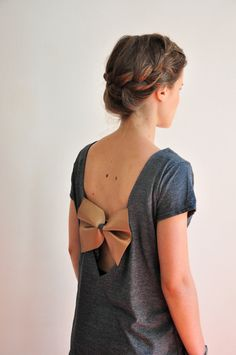 Adding a beautiful details on a casual tee shirt changes everything - Back less tee-shirt with a gold big bow - $31.00