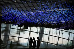 Workers clean a function room, April 23, 2013, in Singapore. (Wong Maye-E/Associated Press)#