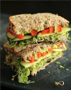 The Ultimate Veggie Sandwich  2 slices whole grain sandwich bread Half an avocado, mashed Kosher salt Freshly ground black pepper Raw sunflower seeds Lettuce Alfalfa sprouts Cucumber slices Red bell pepper strips Radish slices Additional toppings as desired: hummus, pesto, cheese, pickles, tomatoes, etc.