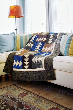 This masculine quilt pattern - Birds of a Feather by Scott A. Flanagan - is perfect for a husband, son, or father. This project is fat quarter friendly, so if you like fat quarter quilt patterns, check this out! Get free crib-size and queen-size versions of this quilt.