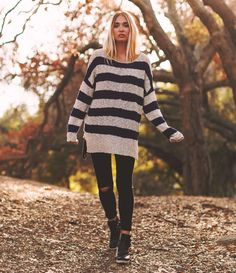 The Poppy field Textured Striped Knit Sweater is an oversized, boyfriend sweater, striped and textured, knit loosely for a tantalizing semi-transparency.