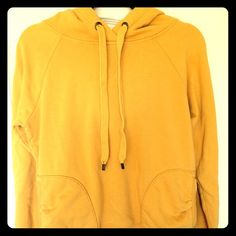 Mustard yellow sweatshirt with pockets I LOVE this sweatshirt but it's too small on me now. Good condition! Size medium from Old Navy. Inside of hood has a cute pattern. Old Navy Tops Sweatshirts & Hoodies