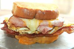 Texas Size Breakfast Sandwich with Bacon, Egg, Ham, and Cheese