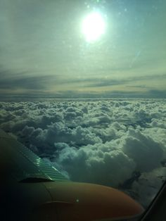 Puffy clouds. No matter how bad the weather might be on the ground, if you go high enough the sun is shining :)