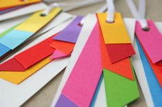 really cute; card stock cut in geometric shapes, stacked and tie together...