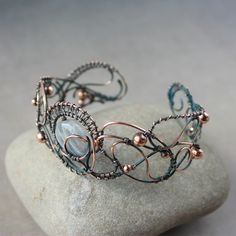 'Evening lights' by WhiteSquaw - a very open & delicate looking wirework bracelet.