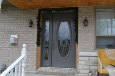 OVAL DOOR INSERT AND SINGLE SIDELIGHT. STEEL GREY DOOR BY THE WINDOW & DOOR SPECIALIST LTD.  604 EDWARD AVE UNIT 3  RICHMOND HILL, ON.  CALL US TODAY FOR YOUR FREE  IN HOME ESTIMATE 905.770.3719