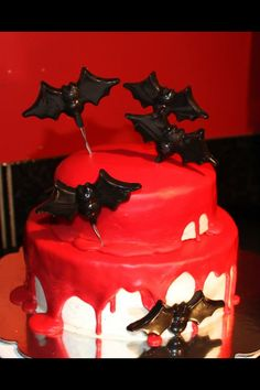 Vampire bat Halloween cake  Red velvet cake filled with buttercream covered in marshmallow fondant and ganache with chocolate bats