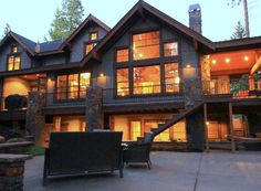 Mountain Lodge with Striking Open Floor Plan - 23654JD | 1st Floor Master Suite, Bonus Room, Butler Walk-in Pantry, CAD Available, Craftsman, Luxury, Mountain, Northwest, PDF, Photo Gallery, Premium Collection, Sloping Lot, Vacation, Wrap Around Porch | Architectural Designs