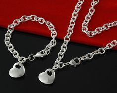 """Beautiful thick Sterling Silver Chain Link Heart Pendant Necklace and Bracelet set. This set features heart charms on a necklace and bracelet of thick chain set in 925 Sterling Silver Plate. The heart charm is 3/4"""" wide and carry the 925 stamp. 