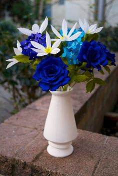 Handmade paper flower bouquet comprised of blue hydrangeas, white clematis, and blue roses.Bouquet consists of 2 stems of hydrangeas, 3 roses, and 6 clematis. Rose Wedding Bouquet, Wedding Table Flowers, Flower Crown Wedding, White Clematis, White Hydrangeas, Flower Arrangement Designs, Flower Arrangements, Paper Flowers Diy, Handmade Flowers