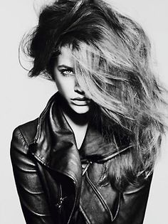 Headshot, black and white, model, leather jacket, big hair, shadows, love the one eye covered.