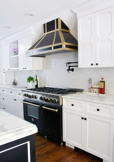 Custom Black Kitchen Hood - Design photos, ideas and inspiration. Amazing gallery of interior design and decorating ideas of Custom Black Kitchen Hood in bathrooms, kitchens by elite interior designers. Kitchen Hoods, New Kitchen, Kitchen Decor, Kitchen Cabinets, Kitchen Ideas, White Cabinets, Kitchen Stuff, Kitchen Magic, Kitchen Inspiration