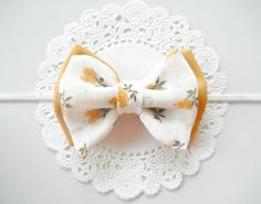 Baby Fabric Bow Headband - Vintage Fabric Bow - Mustard Yellow. $7.00, via Etsy.