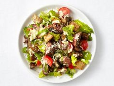 Make salad the star of your dinner with these hearty, easy-to-make healthy salad recipes from Food Network chefs.